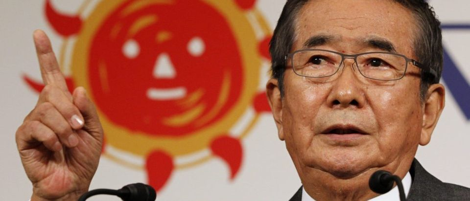 "Former Tokyo Governor Ishihara speaks in front of the logo of his new ""Sunrise Party"" during a news conference in Tokyo"