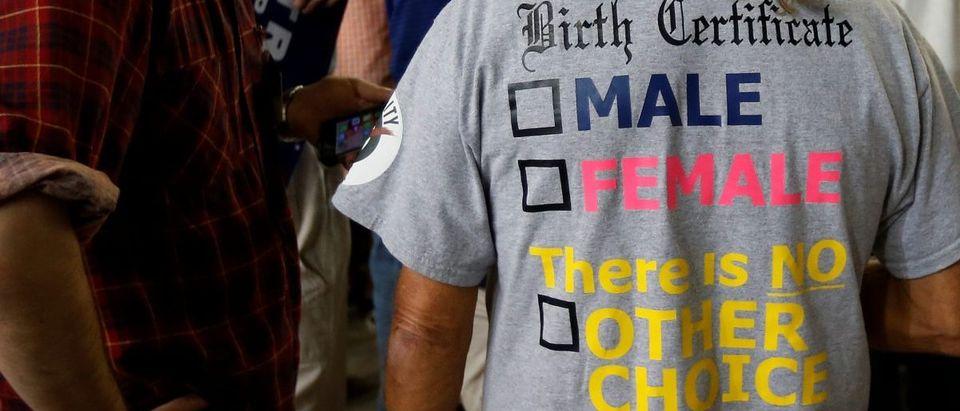 A man wears an anti-transgender shirt before a U.S. President Donald Trump rally in Harrisburg, Pennsylvania, U.S. April 29, 2017. REUTERS/Carlo Allegri