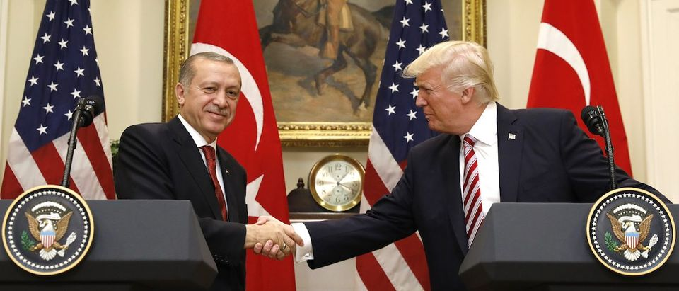 Turkey's President Erdogan shakes hands with U.S. President Trump in the Roosevelt Room of the White House in Washington