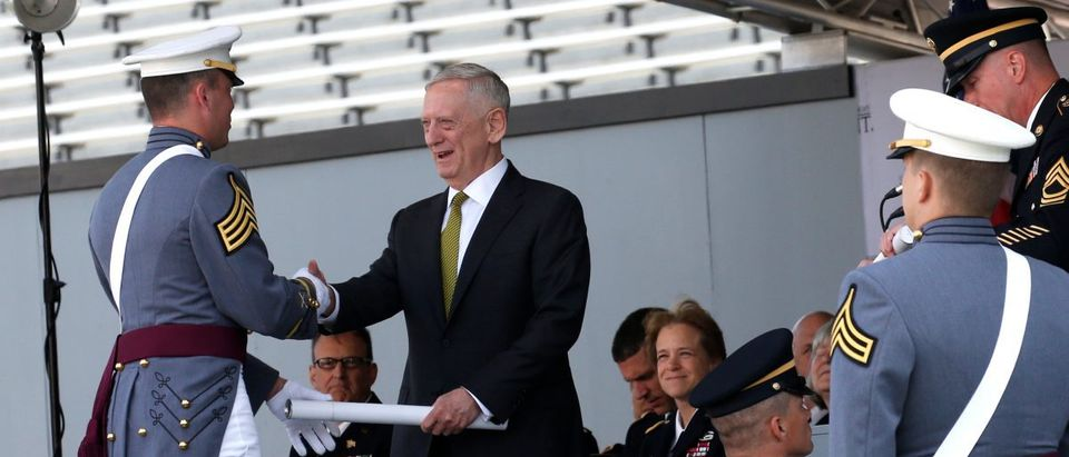 U.S. Secretary of Defense James Mattis presents a diploma to Class President Mario Andrew Contreras Jr. during commencement ceremonies at the United States Military Academy in West Point