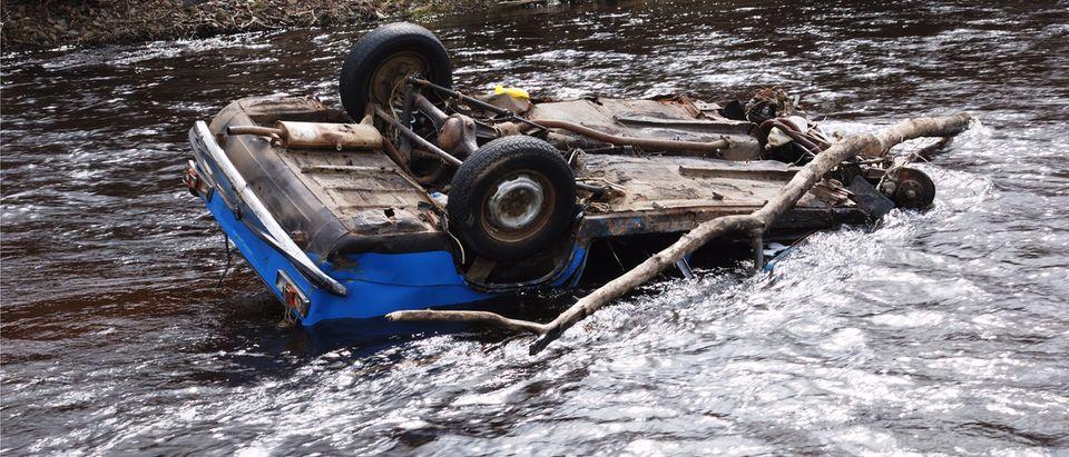 Car overturned in river