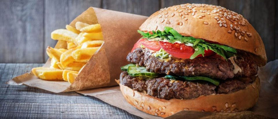 A new Shake Shack opening up in New York City's East Village is trading human cashiers in for robots in order to pay the rest of the shop's employees a $15 an hour wage. (Shutterstock)