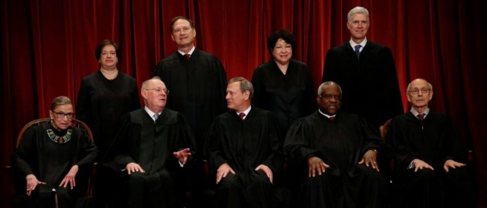 U.S. Chief Justice John Roberts (seated C) leads Justice Ruth Bader Ginsburg (front row, L-R), Justice Anthony Kennedy, Justice Clarence Thomas, Justice Stephen Breyer, Justice Elena Kagan (back row, L-R), Justice Samuel Alito, Justice Sonia Sotomayor, and Justice Neil Gorsuch in taking a new family photo including Gorsuch, their most recent addition, at the Supreme Court building in Washington, D.C., U.S., June 1, 2017. REUTERS/Jonathan Ernst