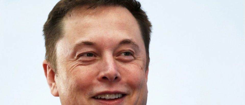 FILE PHOTO: Tesla Chief Executive Elon Musk smiles as he attends a forum on startups in Hong Kong, China January 26, 2016. REUTERS/Bobby Yip/File Photo