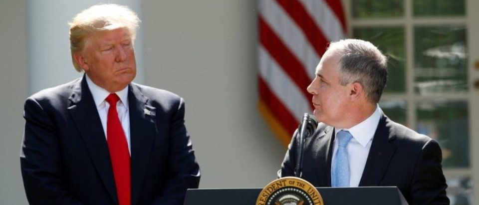 U.S. President Trump listens to EPA Administrator Pruitt after announcing decision to withdraw from Paris Climate Agreement in the White House Rose Garden in Washington