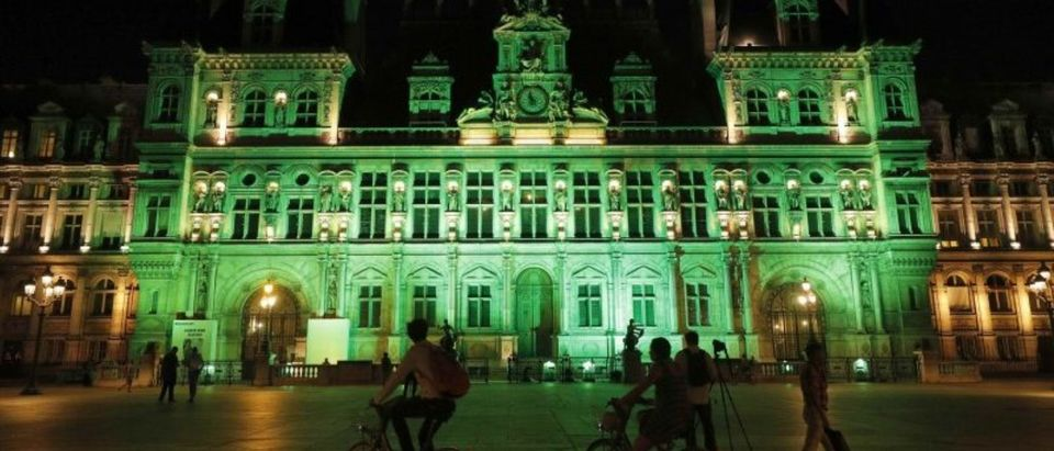 Green lights are projected onto the facade of the Hotel de Ville in Paris, France, after U.S. President Donald Trump announced his decision that the United States will withdraw from the Paris Climate Agreement
