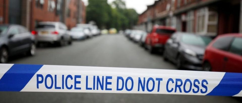 Police cordon off the road in Rusholme, Manchester