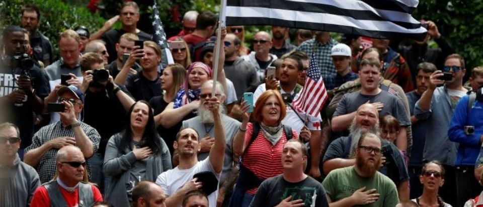 Conservative protesters recite the National Anthem during competing demonstrations in Portland, Oregon, U.S.