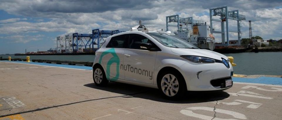A self-driving car being developed by nuTonomy, a company creating software for autonomous vehicles, is guided down a street near their offices in Boston