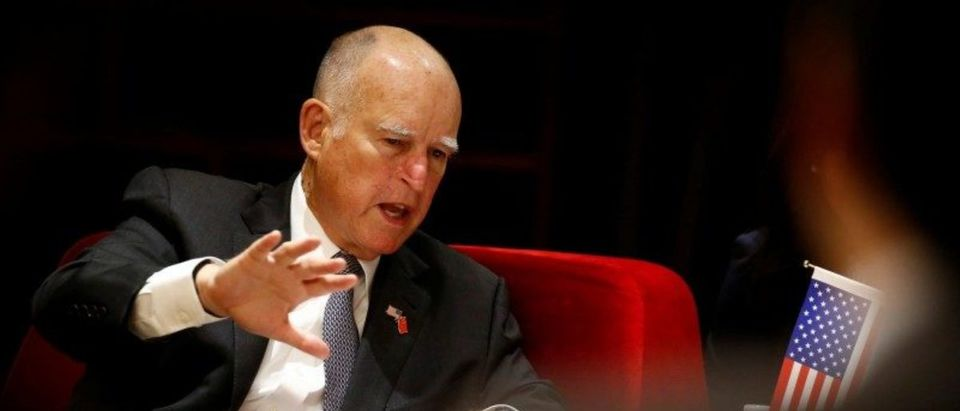 California Governor Jerry Brown attends the International Forum on Electric Vehicle Pilot Cities and Industrial Development in Beijing, China June 6, 2017. (Photo: REUTERS/Thomas Peter)