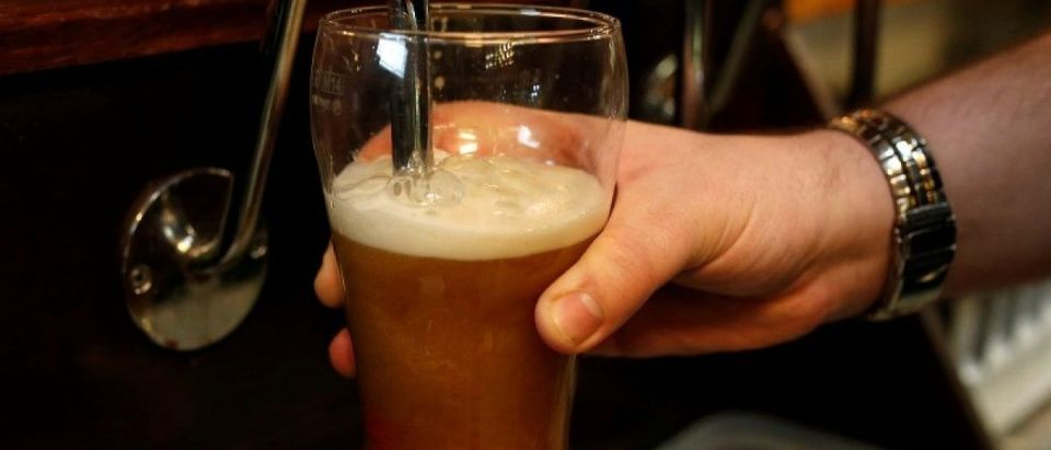 FILE PHOTO: A barman pulls a pint of beer in a pub in Liverpool northern England