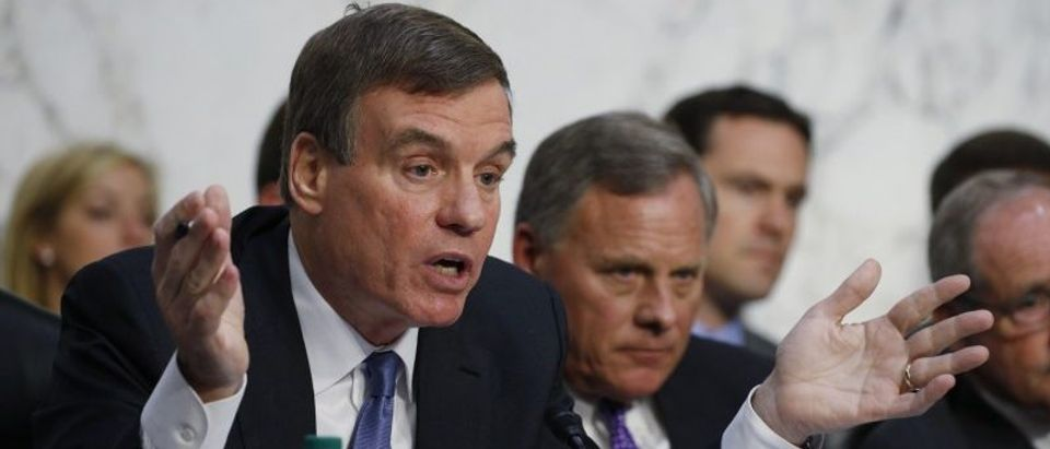 Senate Intelligence Committee Vice Chairman Warner questions intelligence chiefs at hearing on the Foreign Intelligence Surveillance Act in Washington