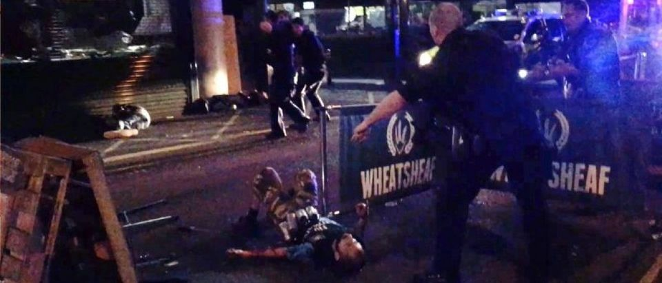 An image taken from video shows three men on the ground after they were shot by police in Borough Market during an attack on London Bridge and the market, in London