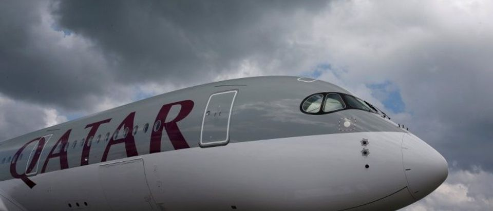 FILE PHOTO:A Qatar Airways Airbus A350 XWB aircraft is displayed at the Singapore Airshow at Changi Exhibition Center