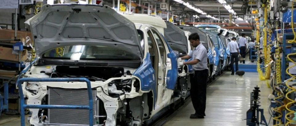 FILE PHOTO: Employees work inside a plant of General Motors India Ltd. at Halol