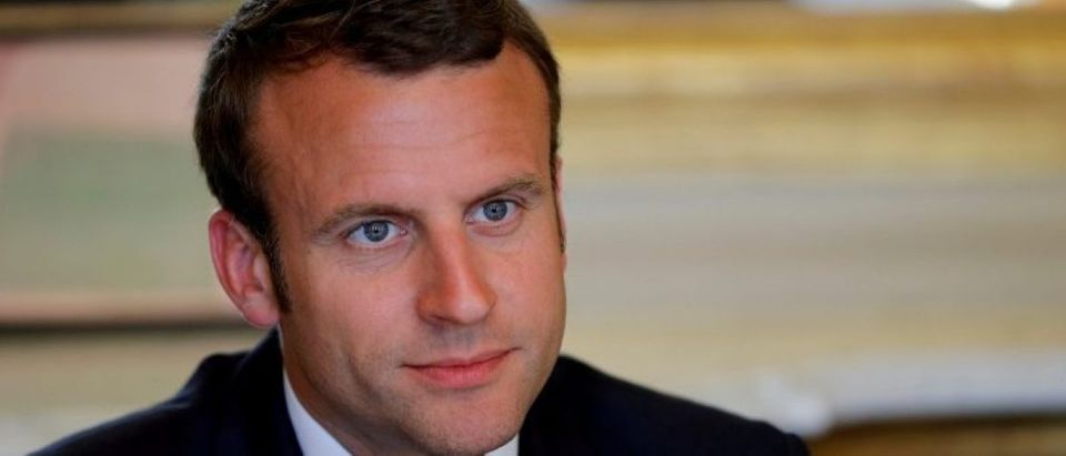 FILE PHOTO: French President Emmanuel Macron attends a meeting at the Elysee Palace in Paris