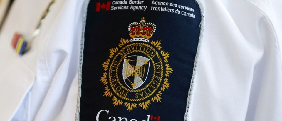 FILE PHOTO: A Canada Border Services Agency (CBSA) logo is seen on a worker during a tour of the Infield Terminal at Toronto Pearson International Airport, Mississauga