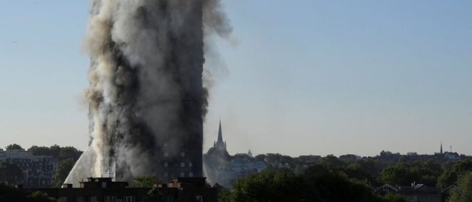 Smoke billows as firefighters deal with a serious fire in a tower block at Latimer Road in West London