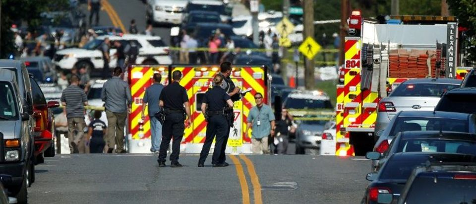 Police survey a shooting scene after a gunman opened fire on Republican members of Congress during a baseball practice in Alexandria, Virginia