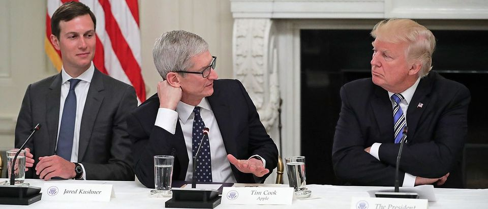 "Apple CEO Tim Cook delivers brief remarks as U.S. President Donald Trump (R) and White House Director of the Office of American Innovation and the president's son-in-law Jared Kushner listen during a meeting of the American Technology Council in the State Dining Room of the White House June 19, 2017 in Washington, DC. According to the White House, the council's goal is ""to explore how to transform and modernize government information technology."" (Photo by Chip Somodevilla/Getty Images)"