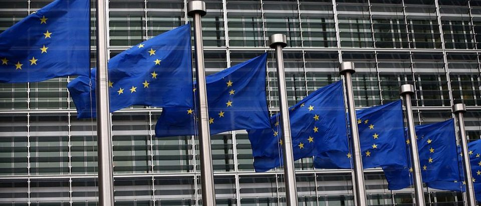 BRUSSELS, BELGIUM - OCTOBER 24: European Union flags are pictured outside the European Commission building. (Photo by Carl Court/Getty Images)