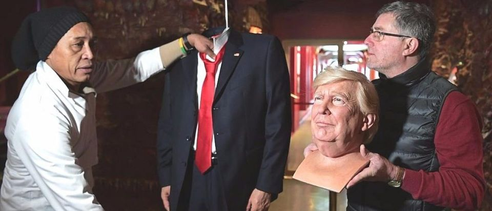 Sculptors bring in the head and body of the waxwork model of US President-elect Donald Trump ahead of its unveiling at the Grevin museum in Paris on January 19, 2017. (Photo credit: CHRISTOPHE ARCHAMBAULT/AFP/Getty Images)