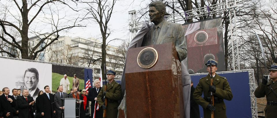 Poland's former president Walesa unveils a statue of former U.S. president Reagan during a ceremony in Warsaw