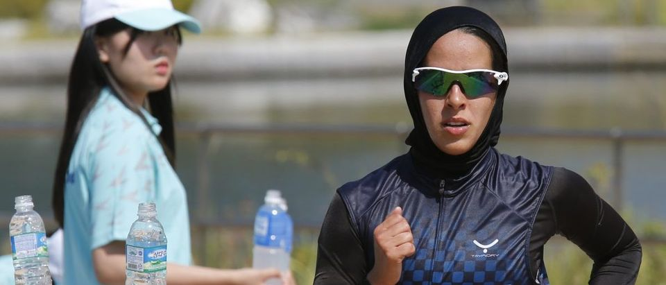 Kuwait's Najlaa I M Aljerewi, wearing a hijab, runs during the women's triathlon competition at Songdo Central Park during the 17th Asian Games in Incheon September 25, 2014. REUTERS/Kim Kyung-Hoon