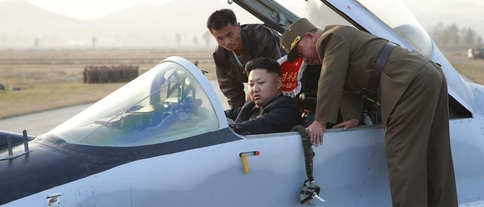 North Korean leader Kim Jong Un sits in an airplane as he guides a flight drill for the inspection of airmen of the Korean People's Army Air and Anti-Air Force
