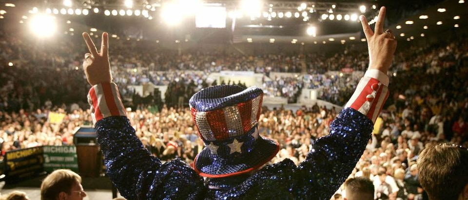 A man dressed as Uncle Sam drums up the crowd at an election campaign rally in Saginaw.