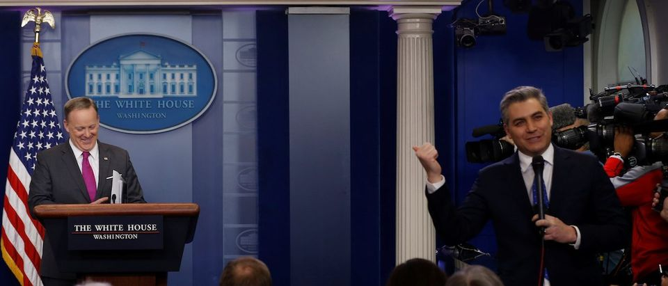 White House Press Secretary Sean Spicer (L) waits for CNN correspondent Jim Acosta (R) to finish speaking on camera before he starts the daily press briefing at the White House in Washington, U.S. March 9, 2017. REUTERS/Jonathan Ernst - RTS126PY