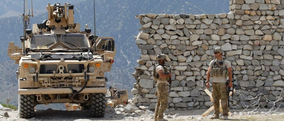 U.S. soldiers stand guard near the site of a U.S. bombing in the Achin district of Nangarhar province in eastern Afghanistan