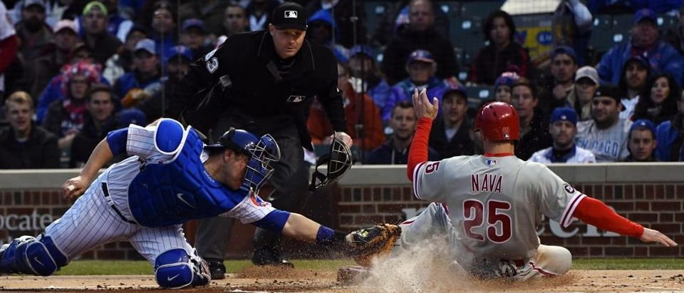 May 3, 2017; Chicago, IL, USA; Chicago Cubs catcher Miguel Montero (47) misses the tag as Philadelphia Phillies right fielder Daniel Nava (25) scores during the first inning at Wrigley Field. Mandatory Credit: Matt Marton-USA TODAY Sports