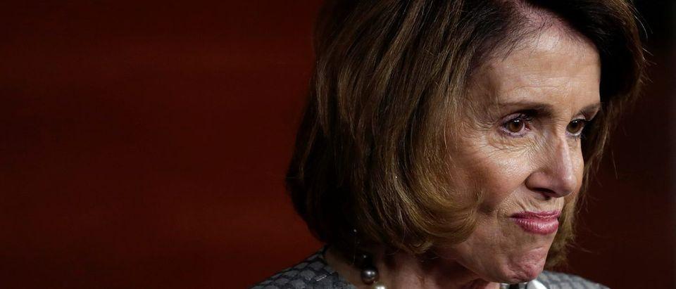 U.S. House Minority Leader Nancy Pelosi (D-CA) reacts