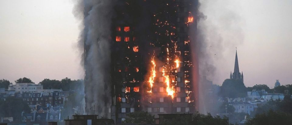 Flames and smoke billow as firefighters deal with a serious fire in a tower block at Latimer Road in West London, Britain June 14, 2017. REUTERS/Toby Melville
