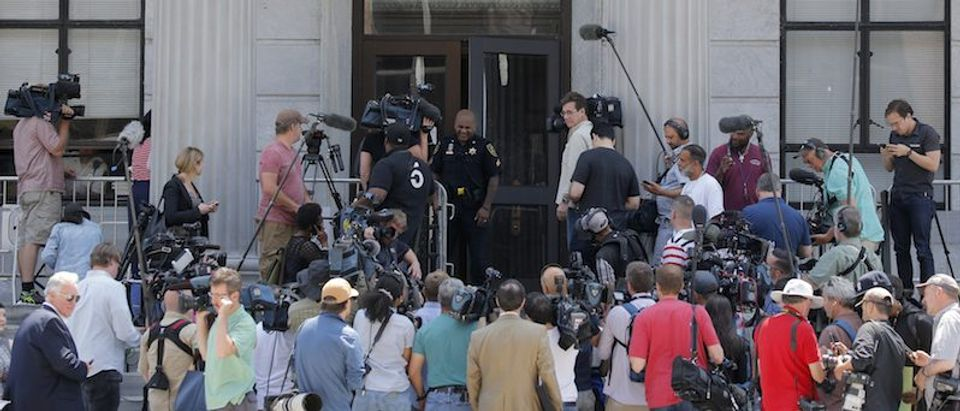 News media assemble outside of the Montgomery County Courthouse on the fourth day of jury deliberation in Bill Cosby's sexual assault trial in Norristown