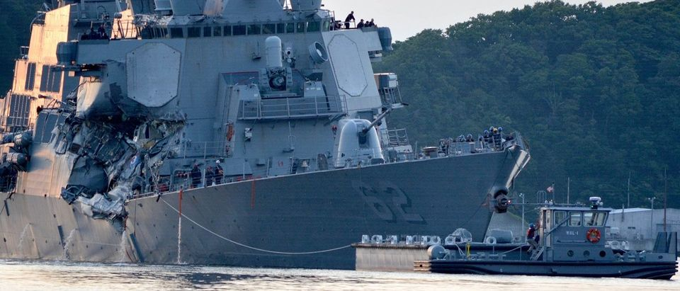 The U.S. Navy Arleigh Burke-class guided-missile destroyer USS Fitzgerald returns to base after a collision off Yokosuka