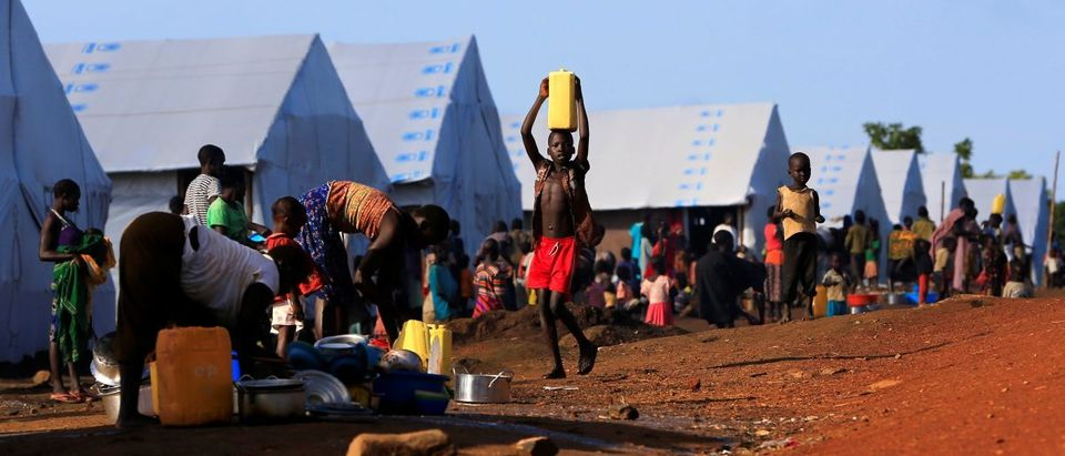 South Sudanese refugees are seen by tents at the Palabek Camp in Lamwo