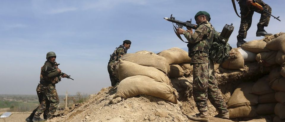 Afghan security forces take their positions at the hilltop of Dand Ghori district of Baghlan