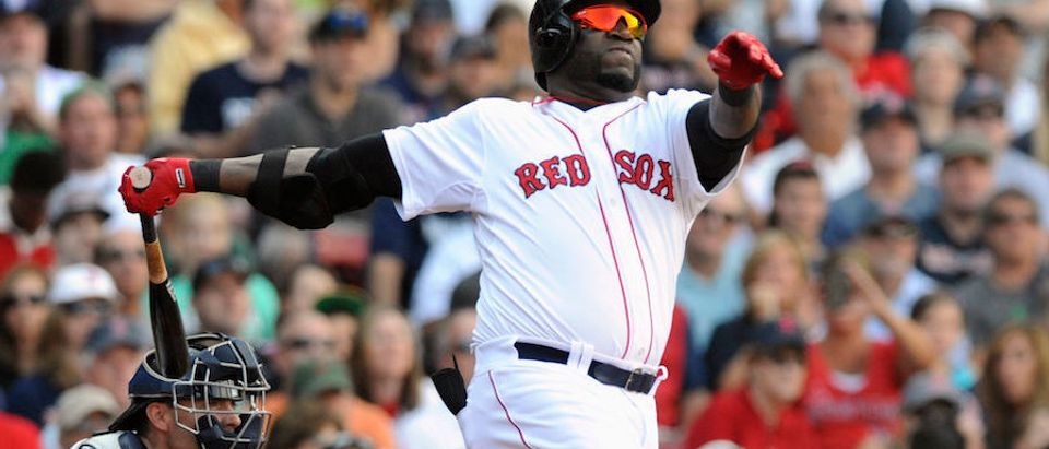 David Ortiz hits a double against a 2013 game against the New York Yankees in Fenway Park (REUTERS/Tory Germann)