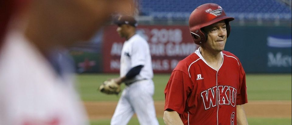 U.S. Senator Rand Paul reacts to striking out during the annual Congressional Baseball Game, pitting Republicans against Democrats for charity, at Nationals Park in Washington