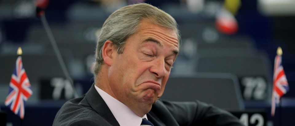 Farage, UKIP member and MEP waits for the start of a debate at the European Parliament in Strasbourg