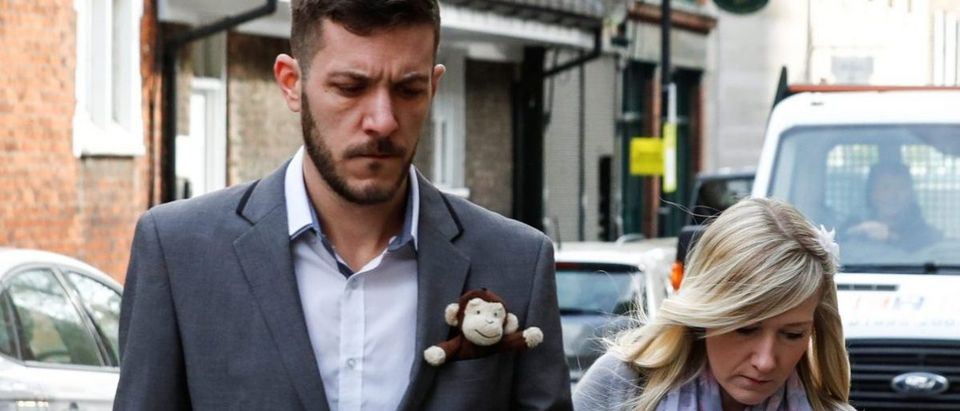 Chris Gard and Connie Yates, who are battling to take their baby Charlie to the US for treatment against advice from doctors that he should be taken off life support arrive at The High Court in London