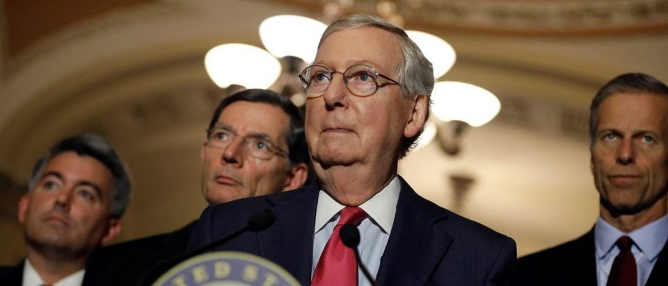 Senate Majority Leader Mitch McConnell, flanked by Sen. Cory Gardner (R-CO), Sen. John Barrasso (R-WY), and Sen. John Thune (R-SD), speaks to reporters after the weekly policy luncheons on Capitol Hill in Washington, D.C., U.S. May 16, 2017. REUTERS/Aaron P. Bernstein