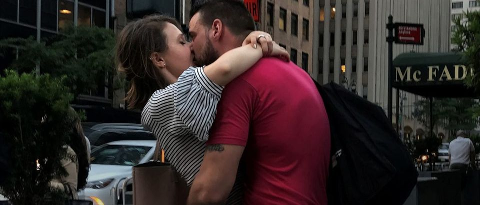A couple kisses on a street corner in the Manhattan borough of New York City, New York, U.S. June 1, 2017.REUTERS/Carlo Allegri