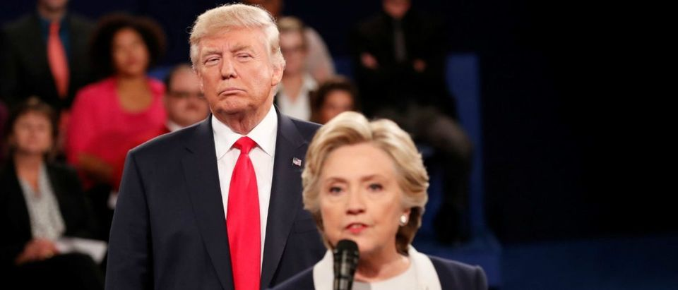 Republican U.S. presidential nominee Donald Trump listens as Democratic nominee Hillary Clinton answers a question