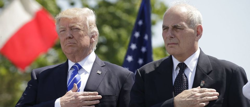 President Trump holds hand over heart with DHS Secretary Kelly at U.S. Coast Guard commencement in New London