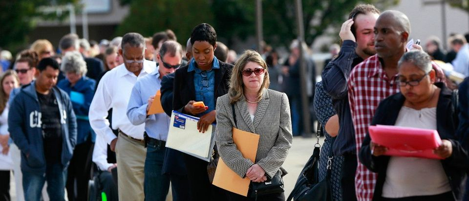 People wait in line to enter the Nassau County Mega Job Fair at Nassau Veterans Memorial Coliseum in Uniondale, New York. (Photo: REUTERS/Shannon Stapleton)