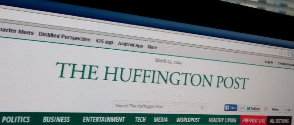 The logo of news website The Huffington Post is seen on a computer screen in Washington on March 25, 2014. AFP PHOTO/Nicholas KAMM/Getty