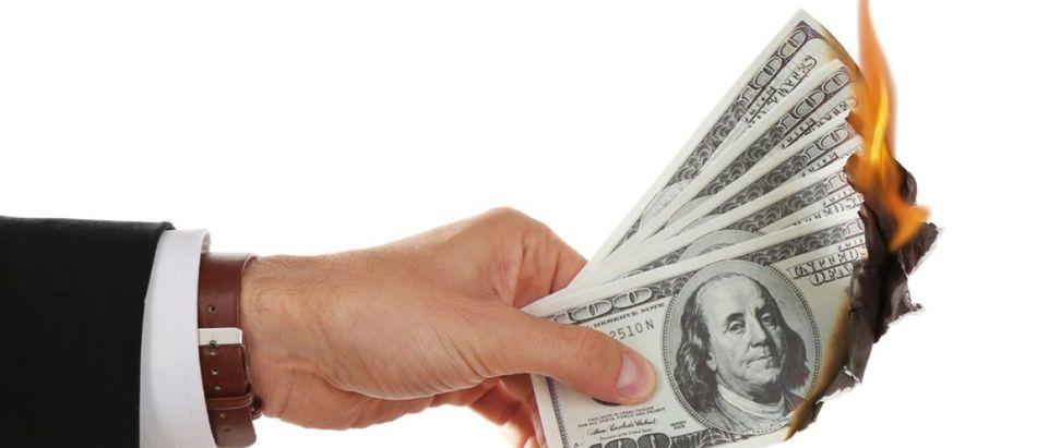 Burning $100 bills and cash